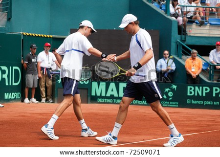 SANTIAGO, CHILE - MAR 5: The USA couple, Bob and Mike Bryan playing in the match against Chile during the third match valid for the Davis Cup. March 5, 2011 in Santiago Chile. - stock photo