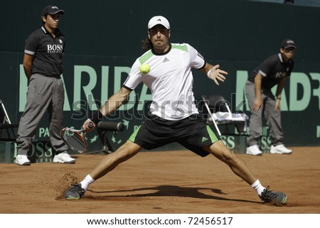 SANTIAGO, CHILE - MAR 4: uses his forehand in the match against  during the first match valid for the Davis Cup. March 4, 2011 in Santiago Chile. - stock photo