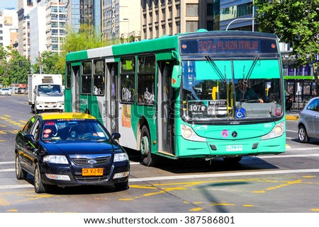 SANTIAGO, CHILE - NOVEMBER 13, 2015: Green city bus Caio in the city street. - stock photo
