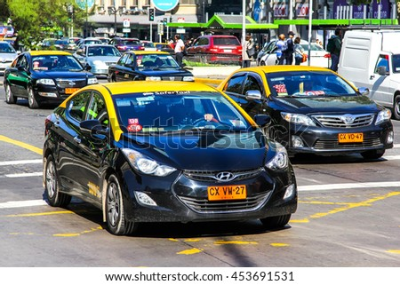 SANTIAGO, CHILE - NOVEMBER 13, 2015: Taxi car Hyundai i40 in the city street. - stock photo