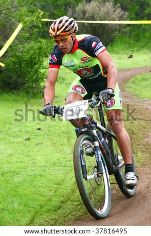 SANTIAGO, CHILE - SEPTEMBER 27: Rider number 10 goes downhill on Alpes Cup, mountain bike competition on September 27, 2009 in Santiago, Chile. - stock photo