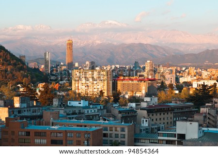 Santiago de Chile, panoramic view of the center at evening with snowy Andes - stock photo