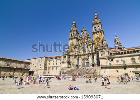 SANTIAGO DE COMPOSTELA - AUGUST 19: View of Obradoiro square and cathedral of Santiago, one of the most important Christian pilgrimage places, on August 19, 2013, in Santiago de Compostela, Spain. - stock photo