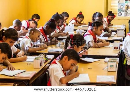 SANTIAGO DE CUBA,  CUBA - FEB 1, 2016: Children in the classroom in the former La Moncada barracks, important place of Cuban history, Santiago de Cuba - stock photo