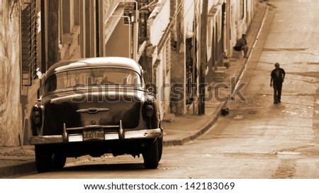 SANTIAGO DE CUBA - DECEMBER 27: A classic Chevrolet car in a street on December 27, 2012 in Santiago de Cuba. These old and classic cars are an iconic sight of the island - stock photo