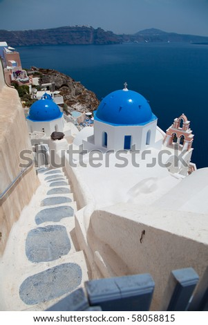 Santorini beautiful volcanic island in Greece landscape with blue churches, windmills and volcanic caldera