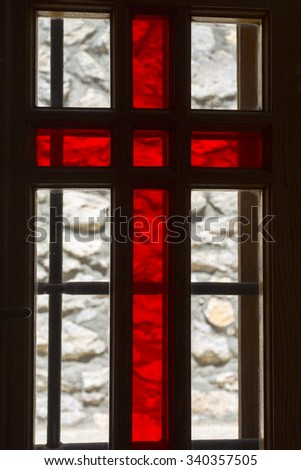 SANTORINI, GREECE, JULY 25: Details of stained antique window with red cross in a church in Santorini, Greece 2013. - stock photo