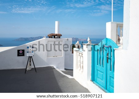 Santorini, Greece - October 17, 2015:  Firostefani, traditional architectures on the caldera pathway