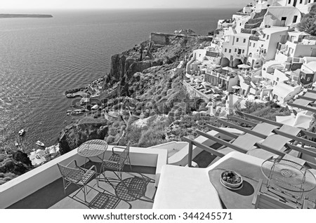 SANTORINI, GREECE - OCTOBER 5, 2015: The luxury resorts in Oia and the Amoudi harbor.
