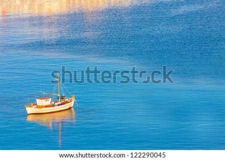 Santorini Greece, White Boat at dawn, Santorini island Greece - stock photo