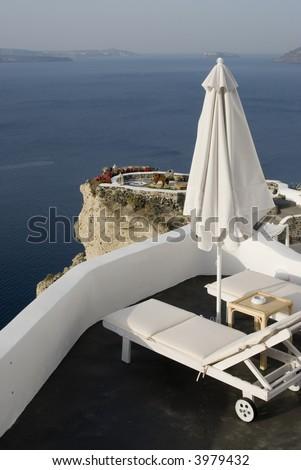 santorini house villa patio deck with view incredible greek islands - stock photo