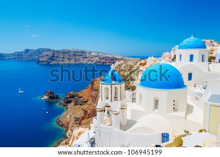 Santorini Island, Greece, Beautiful View of Blue Ocean and Traditional Dome Church Architecture - stock photo