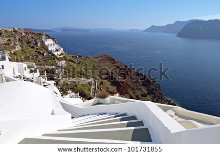 Santorini island in Greece. Village of Oia and scenic steps going downwards to the volcanic caldera