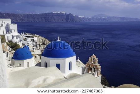 Santorini Island scene with  blue dome churches faces Caldera, Greece - stock photo