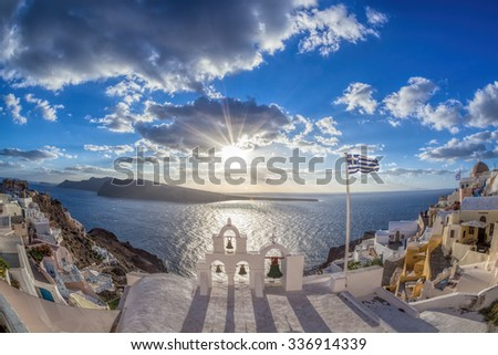 Santorini island with amazing sunset in Oia village, Greece - stock photo