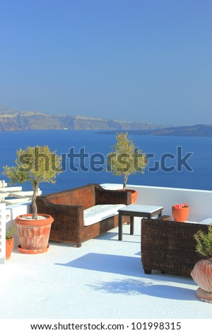 Santorini Oia village terasse by the sea - stock photo