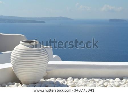 Santorini Picturesque Scene with White Urn - stock photo