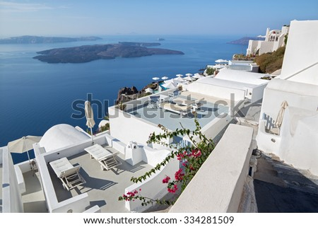 Santorini - The outlook over the luxury resort in Imerovigili to caldera with the cruises.