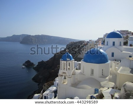 Santorini white and blue houses over the water