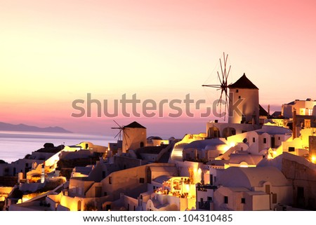 Santorini with windmills in the evening, Greece - stock photo