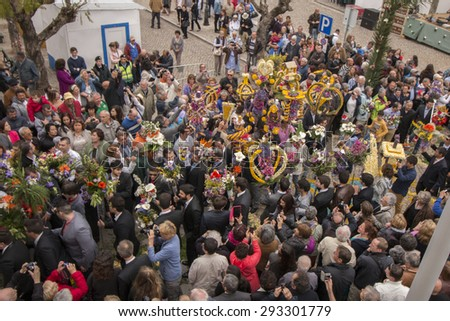 SAO BRAS DE ALPORTEL, PORTUGAL - April 5th, 2015: Traditional religious procession of the flower torches event located in village of Sao Bras de Alportel, Portugal.