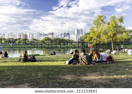 SAO PAULO, BRAZIL - CIRCA AUGUST 2014: People enjoy the Ibirapuera Park. Ibirapuera Park is the largest park in Sao Paulo, Brazil. - stock photo