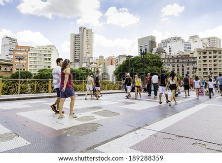 SAO PAULO, BRAZIL - CIRCA MARCH 2014: People walk in Santa Ifigenia viaduct in Sao Paulo, Brazil. Santa Ifigenia is located in downtown with exclusive use for pedestrians. - stock photo