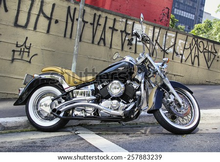 SAO PAULO, BRAZIL - FEBRUARY 08, 2015: A closeup of an old motorcycle at Paulista Avenue at Sao Paulo Brazil. - stock photo
