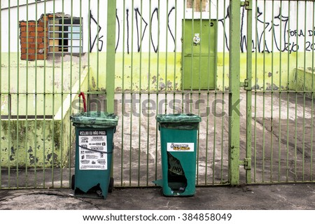 Sao Paulo, Brazil, February 16, 2016. trash cans (garbage bins) broken and tied in a grid on street - stock photo