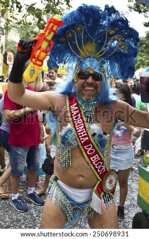 SAO PAULO, BRAZIL - JANUARY 31, 2015: An unidentified man dressed like a woman participate in the annual Brazilian street carnival dancing and singing samba. - stock photo