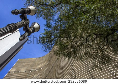 Sao Paulo, Brazil - July 14, 2012: Facade of the Copan building in downtown Sao Paulo. Copan is the largest residential building in the world. - stock photo