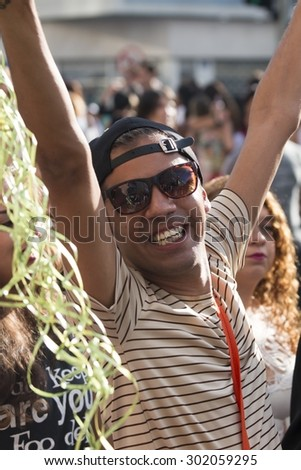 SAO PAULO, BRAZIL - June 7, 2015: An unidentified man, celebrating lesbian, gay, bisexual, and transgender culture in the 19th Gay Pride Parade Sao Paulo - stock photo