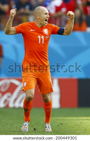 SAO PAULO, BRAZIL - June 23, 2014: Arjen Robben of the Netherlands celebrates after his team scored a goal during the game between Netherlands and Chile at Arena Corinthians. No Use in Brazil. - stock photo