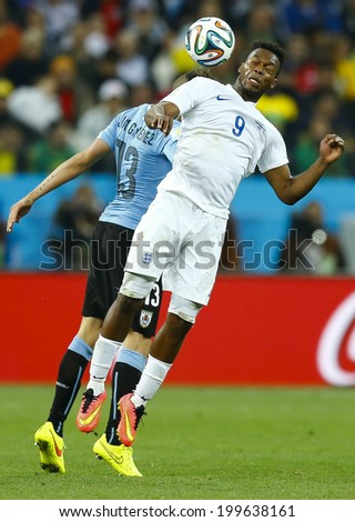 SAO PAULO, BRAZIL - June 19, 2014: Jose Gimenez of Uruguay and Daniel Sturridge of England compete for the ball during the game between Uruguay and England at Arena Corinthians. No Use in Brazil. - stock photo