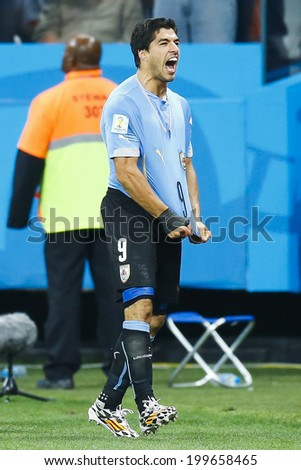 SAO PAULO, BRAZIL - June 19, 2014: Luis Suarez of Uruguay celebrates this goal against England during the 2014 World Cup Group D game at Arena Corinthians. No Use in Brazil. - stock photo