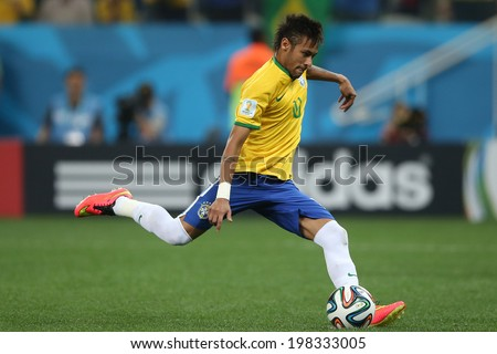 SAO PAULO, BRAZIL - June 12, 2014 : Neymar of Brazil takes a penalty during the World Cup Group A opening game between Brazil and Croatia at Corinthians Arena. No Use in Brazil. - stock photo