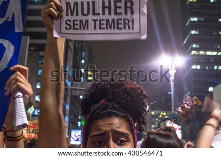 Sao Paulo, Brazil, June 01, 2016: People take part in a protest against the gang-rape of a 16-year-old girl last week in a favela in Rio de Janeiro, in Paulista Avenue in Sao Paulo, Brazil - stock photo