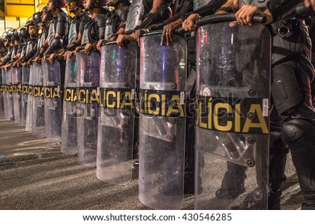 Sao Paulo, Brazil, June 01, 2016: Riot of Military Police during  a protest against the gang-rape of a 16-year-old girl last week in a favela in Rio de Janeiro, in Paulista Avenue in Sao Paulo, Brazil - stock photo