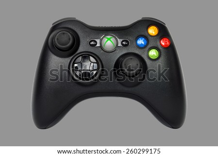 SAO PAULO, BRAZIL - MAR 13, 2014: The wireless gamepad for the Xbox 360, a home video game console produced by Microsoft, isolated on grey 50% background. - stock photo