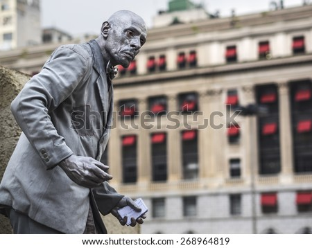 Sao Paulo, Brazil - March 17: Street artist performing as living statue in downtown Sao Paulo, Brazil. - stock photo