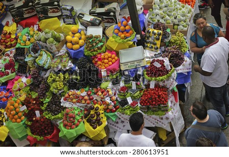 SAO PAULO/BRAZIL - MAY 9: An unidentified man at a fruit stand in Central Market of Sao Paulo on May 09, 2015. This landmark is a destination for tourists and locals. - stock photo