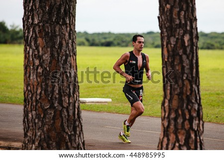 SAO PAULO, BRAZIL - NOVEMBER 24, 2013: Triathlete competes during the run stage in the Long Distance Pirassununga - stock photo