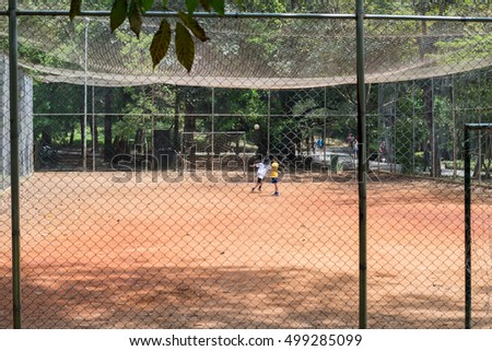 Sao Paulo, Brazil - October 15 2016: Kids playing football at the Aclimacao Park in Sao Paulo, Brazil.