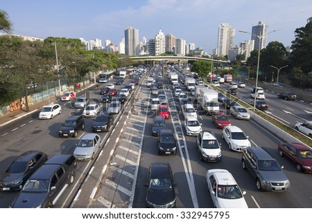 SAO PAULO, BRAZIL - SEPTEMBER 25, 2015: Commuters battle heavy traffic congestion on Avenida 23 de Maio (Avenue 23 of May) during afternoon rush hour in Sao Paulo, Brazil - stock photo