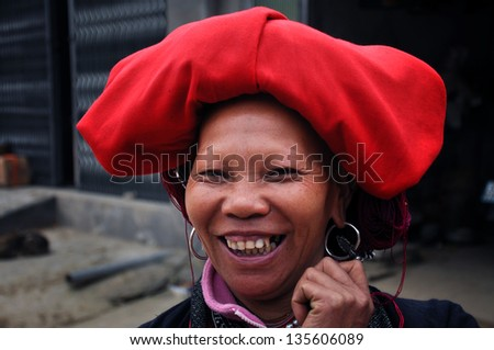 SAPA - FEB 24: Portrait of an unidentified woman from the Red Dao Minority group with a turban. Red Dao Minority are the 9th largest ethnic group in Vietnam. On Feb. 24, 2013 in Sapa, Vietnam