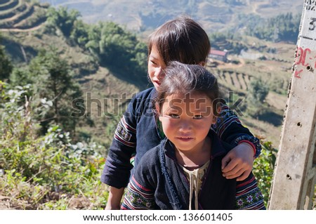 SAPA, VIETNAM - DEC 15: Unidentified Black Hmong tribe girls. on December 15, 2012, in Sapa, Vietnam.The majority of citizens in Sapa are Hmong and Dao people for over 70% of the population - stock photo