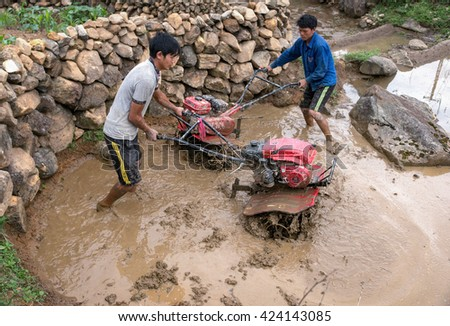 SAPA, VIETNAM, May 18, 2016 FG, highland Sa Pa, plowing terraced fields, rice cultivation