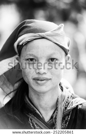 SAPA, VIETNAM - SEP 22, 2014: Unidentified Hmong cute girl in traditional clothes in Sapa. Hmong is on of the minority eethnic group in Vietnam