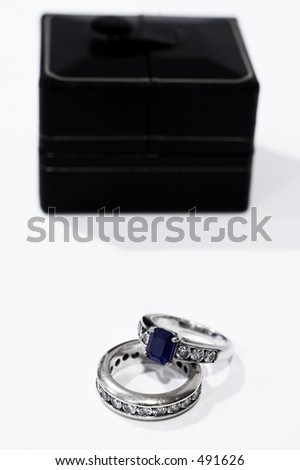 Sapphire and Diamond wedding band and engagement ring picture with ring box - stock photo
