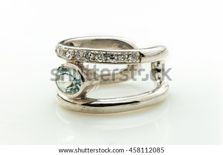 sapphire ring on white background
